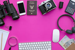 Flat lay of accessories on pink desk background. Of photographer, Voyage concept Royalty Free Stock Image