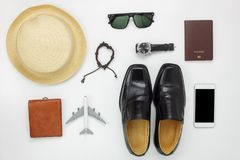 Flat lay of accessories travel and fashion men concept background. Essential items for trip on the white wooden at home office desk.Variety objects for Stock Images
