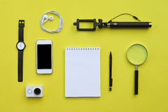 Flat lay of accessories on yellow desk background Stock Photo