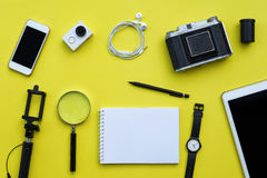 Flat lay of accessories on yellow desk background Royalty Free Stock Photo