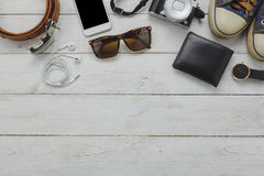 Flat lay of accessory to travel on holidays concept.O. Utfits for teens and young traveler. Variety mix object on modern white table wood background. Essential Royalty Free Stock Image