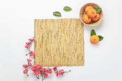 Flat lay aerial image of accessories Lunar vacation & Chinese New Year. Holiday background concept.Bamboo floor of space for mock up & template.Top view orange Stock Images