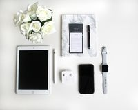 Flat lay: Apple products on black and white background stock image