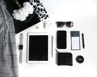Flat lay: Apple products on black and white background royalty free stock images