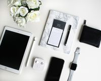 Flat lay: Apple products on black and white background royalty free stock photos