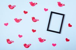 Flat lay arrangement of birds and hearts for mock up design, table top view image of decoration valentine's day background. Concept for post card stock photography