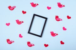 Flat lay arrangement of birds and hearts for mock up design, table top view image of decoration valentine's day background. Concept for post card royalty free stock photo