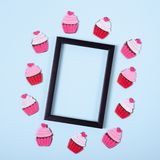 Flat lay arrangement of cupcakes for mock up design, table top view image of decoration valentine's day background. Concept for post card royalty free stock photos