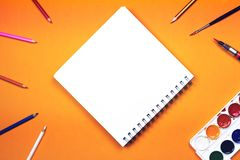 Flat lay of art supplies and notebook with colorful hand lettere Stock Images