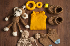 Flat lay.Baby knitted clothes and toys Stock Photography
