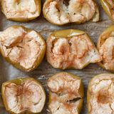 Flat-lay of baked apples. baked halves of apples with honey, cinnamon stock photos