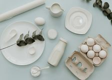 Flat Lay Baking Composition on Pastel Background. Cooking preparation with milk royalty free stock photo