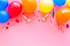 Flat lay with ballons - party concept - on pink background top-down copy space