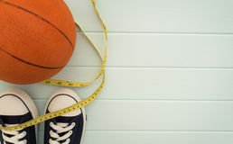 Flat lay : Basketball, Measuring Tape, Sneakers. Basketball, Measuring Tape, Sneakers flat lay on wooden background Stock Photo