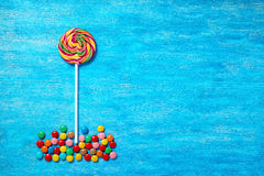 Flat lay of beautiful multicolored lollipop and sweet bonbons on Royalty Free Stock Photos