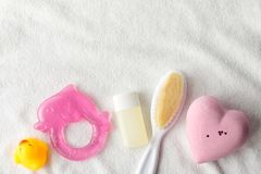 Flat lay beauty photo pink heart, liquid soap bottle and yellow duck baby toy on a white background. Toiletries kit stock photo