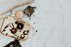 Flat Lay in bed with woman accessories on grey linen. royalty free stock photos