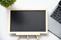 Flat lay blackboard and Laptop stock image