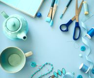 Flat lay blue color objects and accessories frame on light blue background. With copy space royalty free stock images