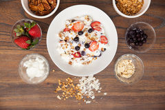 Flat lay of a bowl of yogurt with fruit Royalty Free Stock Photos