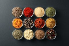 Free Flat Lay. Bowls With Different Spices On Black Stock Image - 167573511