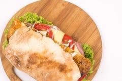 Flat lay bread sandwich meat lettuce tomato Stock Image
