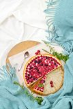 Flat lay breakfast in bed with raspberry cheesecake, mint tea Royalty Free Stock Photo