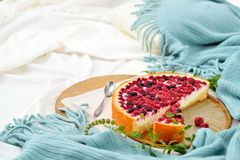 Flat lay breakfast in bed with raspberry cheesecake, mint tea Stock Photo