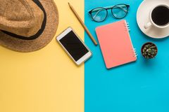 Flat lay business and travel colorful background. Flat lay business and travel colorful two tone background Stock Image