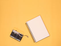 Flat Lay Camera 1. Flat Lay, Top View of Camera and photography tool on yellow background with space Stock Photos
