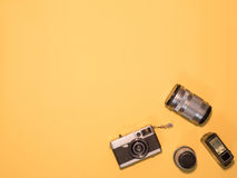 Flat Lay Camera 1. Flat Lay, Top View of Camera and photography tool on yellow background with space Royalty Free Stock Photography