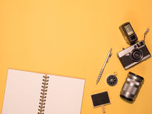 Flat Lay Camera 1. Flat Lay, Top View of Camera and photography tool on yellow background with space Royalty Free Stock Photos