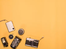 Flat Lay Camera 1. Flat Lay, Top View of Camera and photography tool on yellow background with space Stock Photography