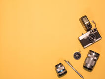 Flat Lay Camera 1. Flat Lay, Top View of Camera and photography tool on yellow background with space Stock Images