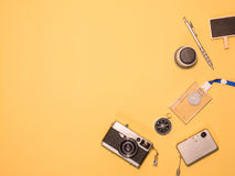 Flat Lay Camera 1. Flat Lay, Top View of Camera and photography tool on yellow background with space Royalty Free Stock Image