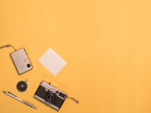 Flat Lay Camera 1. Flat Lay, Top View of Camera and photography tool on yellow background with space Stock Image