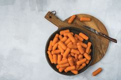 Top view carrots on plate and cutting board. stock image