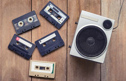 Flat lay of Cassette tape and speaker laying down royalty free stock image