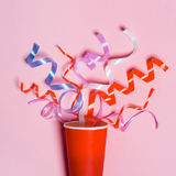 Flat lay of Celebration. Paper cup with colorful party streamers Royalty Free Stock Photo