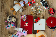Flat lay of child toys on wooden background. Top view. Flat lay of some toys, toy boxes and seashores on wooden background royalty free stock photography