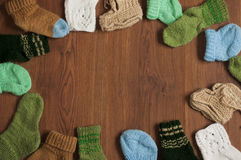 Flat lay children knitted socks background with free space for text. Flat Royalty Free Stock Images