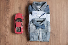 Flat lay children's wear for boy with toy car Stock Image
