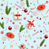 Christmas boxes pattern. Flat lay Christmas composition with fir tree branches on light holiday background. Top view of Natural design elements. Festive Stock Photos