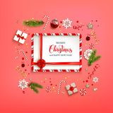 Red winter card. Flat lay Christmas composition with fir tree branches on red holiday background. Top view of Natural design elements. Festive background with Royalty Free Stock Image