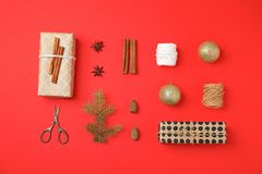 Christmas composition with gift boxes and festive decor on color background. Flat lay Christmas composition with gift boxes and festive decor on color background Stock Images