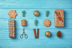 Flat lay Christmas composition with gift boxes. And festive decor on wooden background Stock Image