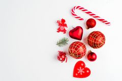 Flat lay Christmas composition with heart, branch, Christmas candy, stripes, Christmas tree, ball, angel, bell and holiday ornamen. Flat lay Christmas royalty free stock images