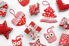 Flat lay. Christmas, gifts, Christmas boxes and Christmas toys on a white table royalty free stock photography