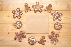 Flat lay of Christmas gingerbread biscuits with craft paper Royalty Free Stock Photography