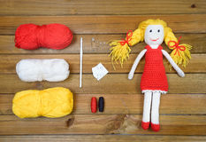 Flat lay of chrochet doll and materials for craft Stock Photos